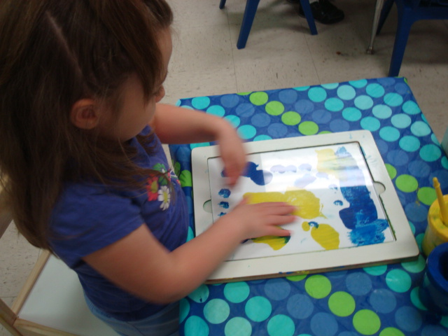 Preschool girl painting in the style of Picasso.