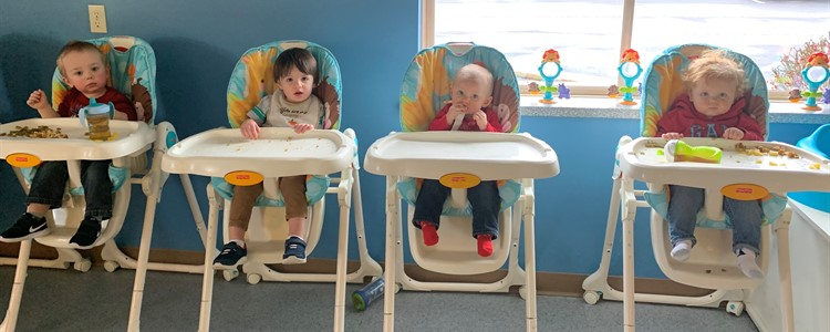 Lunch time in the infant/toddler room.