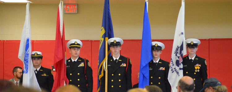 The BCHS NJROTC Color Guard presents the flags of the military branches.
