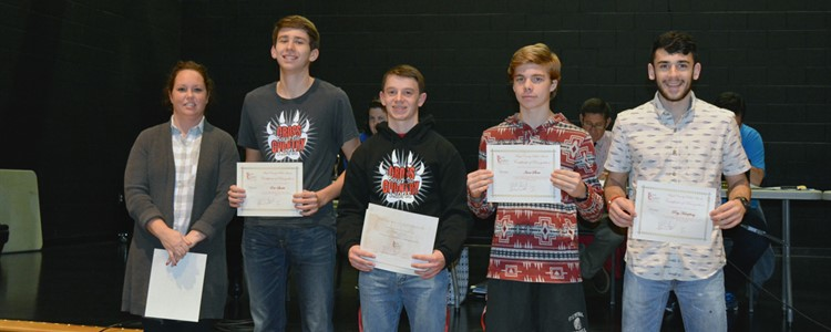 The All-Area Cross Country Team members were recognized at the January BOE meeting. Pictured, left to right:  Becca Chaney - Coach, Eric Sparks, Elijah Miller, Isaac Slone and Ray Humphrey. Elijah Miller (third from left)  was named Runner of the Year for the second year in a row.