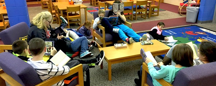 Students enjoying the new arrangement in the library.