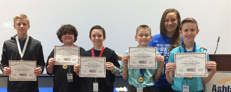 Winners in the Physics and Astronomy category proudly hold their certificates. Second from left is Boyd County Middle student Brayden Ryan. Next to him BCMS student Michael Potter. They both won 2nd place in the category.