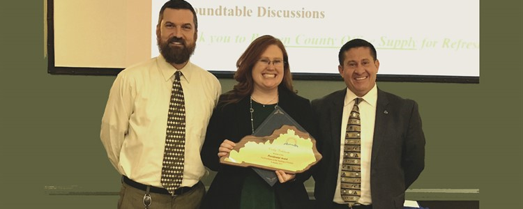 Mrs. Baldwin, at center, is shown here receiving the Presidential Award at the KEDC meeting on February 15th, 2017. To her left is BCHS Principal Thomas Holbrook and to her right is BCPS Superintendent Brock Walter.