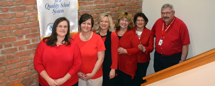 Our Finance Dept. showing support for our teachers and joining other Ky Association of School Business Officials by wearing red. Left to right:  Angie Marcum, Corey Withrow, Lora Adams, Donna Black, Helen Campbell and Don Fleu.