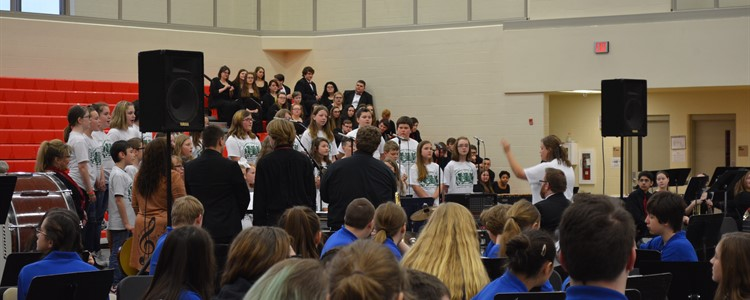 The combined Honors Choir, made up of students from all district elementary schools, sings during the Music In Our Schools concert. Ms. Annie  Johnson directs.