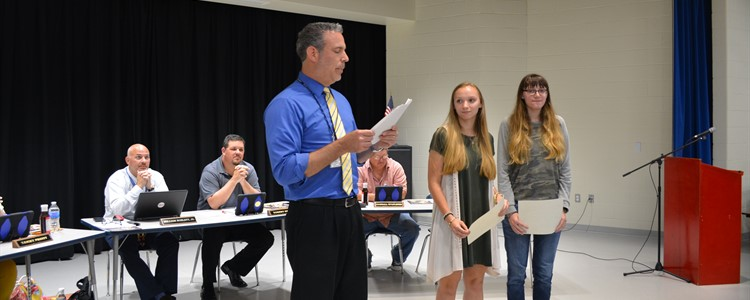 Haylee Winters, center, and Sydney Winters, left, receive recognition for being named to the Morehead State University's Craft Academy. They will spend their junior and senior years earning college credits at MSU.