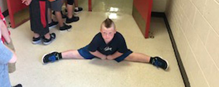 A student does the splits on the first day of school.