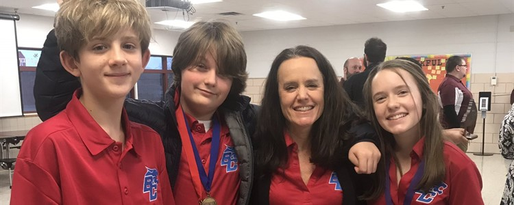 BCMS Academic Team members going to state:  Wren Cragle, Sydney Kinnel, and Noah Carter. They are pictured here with coach Tara Kinnel.