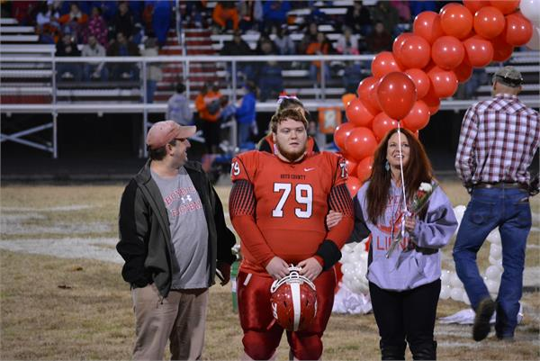 Senior night. A player and his family are recognized before the game, 2015.