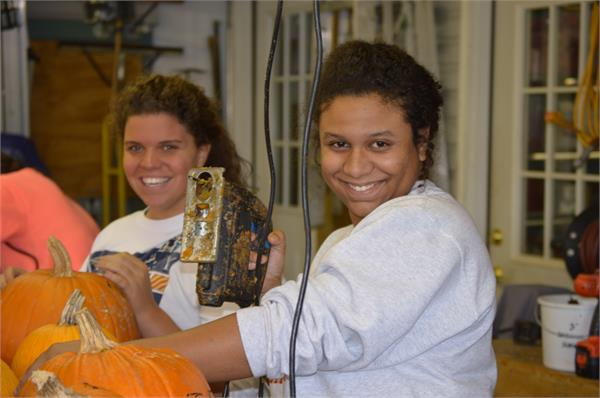 Beta Club members helping to carve pumpkins at the Pumpkin House in Kenova, October 2015.